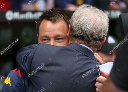 Crystal Palace manager Roy Hodgson greets Aston Villa coach John Terry