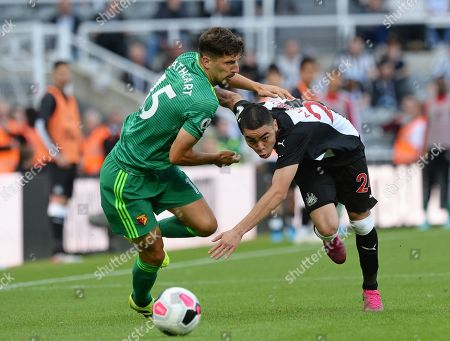 Miguel Almiron of Newcastle United grapple with Craig Cathcart of Watford