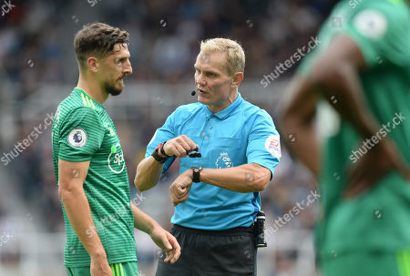 Referee Graham Scott warns Craig Cathcart of Watford of his side?s time wasting