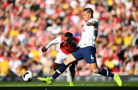 Toby Alderweireld of Tottenham Hotspur battles with Alexandre Lacazette of Arsenal