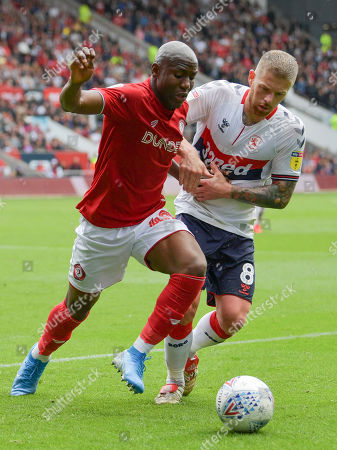 Stock Image of Benik Afobe of Bristol City under pressure from Adam Clayton of Middlesbrough