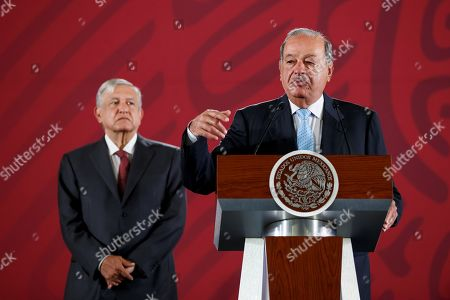 Mexican magnate Carlos Slim (R) and Mexican President Andres Manuel Lopez Obrador speak during a press conference at the National Palace in Mexico City, Mexico, 27 August 2019. Lopez Obrador announced that an agreement was reached with three of the four private companies and seven gas pipeline contracts were being renegotiated, saving 4.5 billion dollars.
