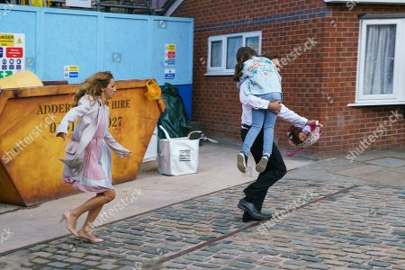 Ep 9864 Monday 2nd September 2019 - 2nd Ep As Ali Neeson, as played by James Burrows, emerges from the smoke filled loading bay carrying Hope Stape, as played by Isobella Flanagan, Fiz Stape and Tyrone Dobbs are overcome with relief.