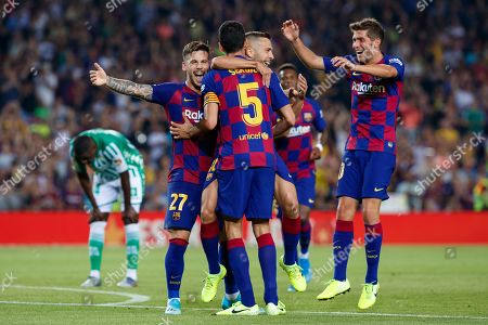 Jordi Alba of FC Barcelona celebrates with Sergio Busquets, Carles Perez and Sergi Roberto after scoring his team's fourth goal
