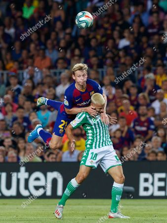 Sergio Canales of Real Betis in action with Frenkie de Jong of FC Barcelona