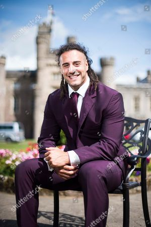 Stock Photo of Wales Rugby player Josh Navidi wearing a Timothy Everest suit at the Vale Resort, South Wales.
