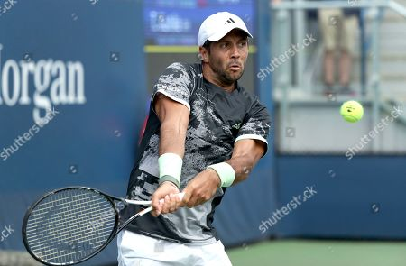 Fernando Verdasco, of Spain, returns a shot to Tobias Kamke, of Germany, during the first round of the US Open tennis tournament, in New York