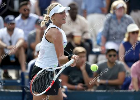 Stock Image of Anett Kontaveit, of Estonia, returns a shot to Sara Sorribes Tormo, of Spain, during the first round of the US Open tennis tournament, in New York