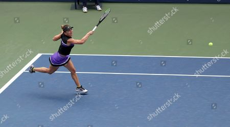 Simona Halep, of Romania, returns a shot to Nicole Gibbs, of the United States, during the first round of the US Open tennis tournament, in New York