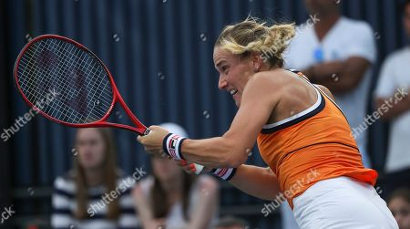 Timea Babos, of Hungary, returns a shot to Carla Suarez Navarro, of Spain, during the first round of the US Open tennis tournament, in New York