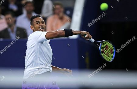 Nick Kyrgios, of Australia, returns to Steve Johnson, of the United States, during the first round of the U.S. Open tennis tournament in New York