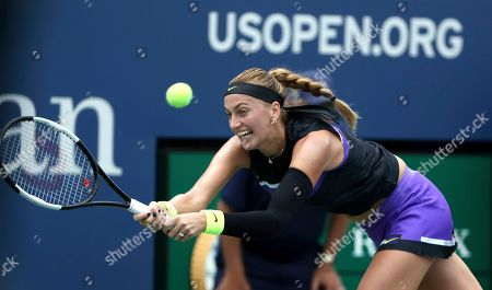 Petra Kvitova, of the Czech Republic, returns a shot to Denisa Allertova, of the Czech Republic, during the first round of the US Open tennis tournament, in New York