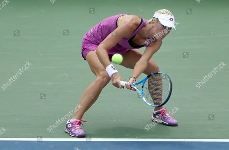 Denisa Allertova, of the Czech Republic, returns a shot to Petra Kvitova, of the Czech Republic, during the first round of the US Open tennis tournament, in New York