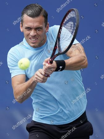 Tobias Kamke of Germany hits a return to Fernando Verdasco of Spain during their match on the second day of the US Open Tennis Championships the USTA National Tennis Center in Flushing Meadows, New York, USA, 27 August 2019. The US Open runs from 26 August through 08 September.