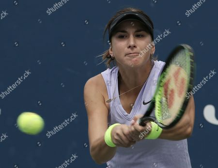 Belinda Bencic of Switzerland hits a return to Mandy Minella of Luxembourg during their match on the second day of the US Open Tennis Championships the USTA National Tennis Center in Flushing Meadows, New York, USA, 27 August 2019. The US Open runs from 26 August through 08 September.