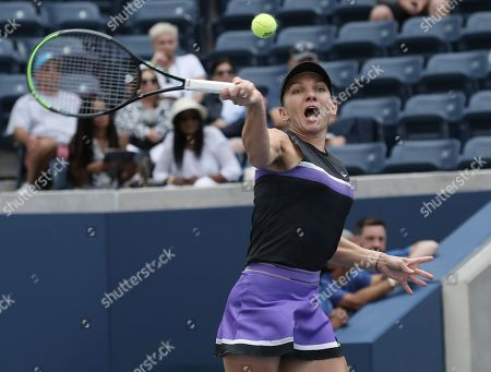 Simona Halep of Romania hits a return to Nicole Gibbs of the US during their match on the second day of the US Open Tennis Championships the USTA National Tennis Center in Flushing Meadows, New York, USA, 27 August 2019. The US Open runs from 26 August through 08 September.