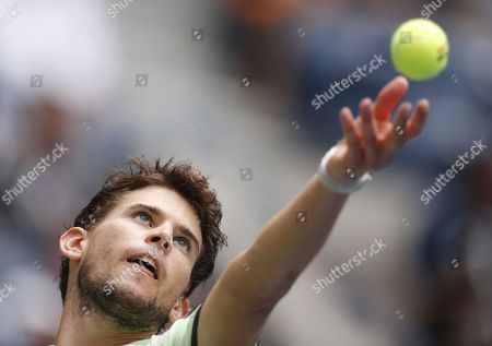 Dominic Thiem of Austria serves to Thomas Fabbiano of Italy during their match on the second day of the US Open Tennis Championships the USTA National Tennis Center in Flushing Meadows, New York, USA, 27 August 2019. The US Open runs from 26 August through 08 September.
