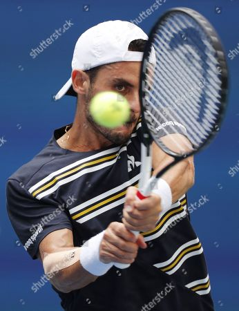 Thomas Fabbiano of Italy hits a return to Dominic Thiem of Austria during their match on the second day of the US Open Tennis Championships the USTA National Tennis Center in Flushing Meadows, New York, USA, 27 August 2019. The US Open runs from 26 August through 08 September.