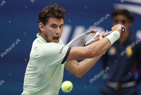 Dominic Thiem of Austria hits a return to Thomas Fabbiano of Italy during their match on the second day of the US Open Tennis Championships the USTA National Tennis Center in Flushing Meadows, New York, USA, 27 August 2019. The US Open runs from 26 August through 08 September.