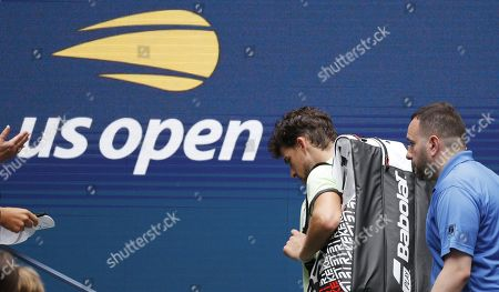 Dominic Thiem of Austria leaves the court after being upset by Thomas Fabbiano of Italy during their match on the second day of the US Open Tennis Championships the USTA National Tennis Center in Flushing Meadows, New York, USA, 27 August 2019. The US Open runs from 26 August through 08 September.