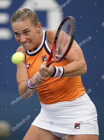 Stock Picture of Timea Babos of Hungary hits a return to Carla Suarez-Navarro of Spain during their match on the second day of the US Open Tennis Championships the USTA National Tennis Center in Flushing Meadows, New York, USA, 27 August 2019. The US Open runs from 26 August through 08 September.