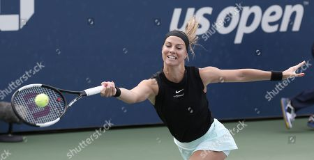 Mandy Minella of Luxembourg hits a return to Belinda Bencic of Switzerland during their match on the second day of the US Open Tennis Championships the USTA National Tennis Center in Flushing Meadows, New York, USA, 27 August 2019. The US Open runs from 26 August through 08 September.