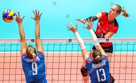 Jana Francizska Poll of Germany (R) in action against Jaroslava Pencova (L) and Lenka Oveckova (C) of Slovakia during the EuroVolley Women 2019 match between Germany and Slovakia in Bratislava, Slovakia, 27 August 2019.