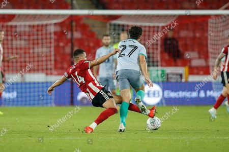Ravel Morrison of Sheffield United fouls Lewis Travis of Blackburn Rovers during the EFL Cup match between Sheffield United and Blackburn Rovers at Bramall Lane, Sheffield