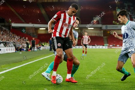 Ravel Morrison of Sheffield United is challenged by Richard Smallwood of Blackburn Rovers during the EFL Cup match between Sheffield United and Blackburn Rovers at Bramall Lane, Sheffield