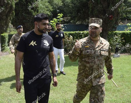 Amir Khan (L), British Boxer of Pakistani origin is briefed by a Pakistani Army officer as he visits Chakothi, the capital of Pakistani administered Kashmir, near Line of Control (LoC) the de facto border between Pakistani and Indian administered Kashmir, Pakistan, 27 August 2019. Amir Khan said he visited Pakistani administered Kashmir to call for peace after the Indian government's decision to revoke the special status of Jammu and Kashmir and divide the state into federally administered territories, Jammu and Kashmir, and Ladakh. Rising tensions are renewed in the region as the Indian government on 05 August moved a resolution in the parliament that removes the special constitutional status granted to the disputed Kashmir region, a decision condemned by Pakistan. Kashmir has been a matter of dispute between India and Pakistan since 1947 when both countries became sovereign states.
