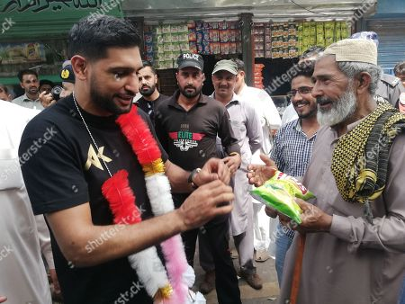Amir Khan, British Boxer of Pakistani origin visits Chakothi, the capital of Pakistani administered Kashmir, near Line of Control (LoC) the de facto border between Pakistani and Indian administered Kashmir, Pakistan, 27 August 2019. Amir Khan said he visited Pakistani administered Kashmir to call for peace after the Indian government's decision to revoke the special status of Jammu and Kashmir and divide the state into federally administered territories, Jammu and Kashmir, and Ladakh. Rising tensions are renewed in the region as the Indian government on 05 August moved a resolution in the parliament that removes the special constitutional status granted to the disputed Kashmir region, a decision condemned by Pakistan. Kashmir has been a matter of dispute between India and Pakistan since 1947 when both countries became sovereign states.