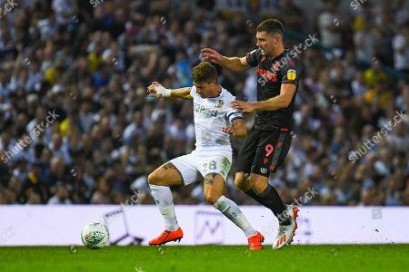 Leeds United defender Gaetano Berardi (28) and Stoke City forward Sam Vokes (9) in action during the EFL Cup match between Leeds United and Stoke City at Elland Road, Leeds