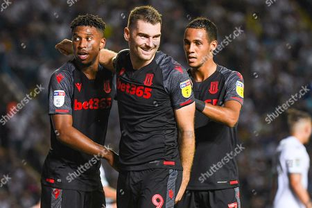 Stoke City forward Sam Vokes (9) scores a goal and celebrates with Stoke City forward Tyrese Campbell (26) and Stoke City midfielder Thomas Ince (7) to make the score 0-2 during the EFL Cup match between Leeds United and Stoke City at Elland Road, Leeds