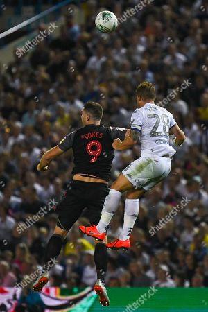 Leeds United defender Gaetano Berardi (28) and Stoke City forward Sam Vokes (9) during the EFL Cup match between Leeds United and Stoke City at Elland Road, Leeds