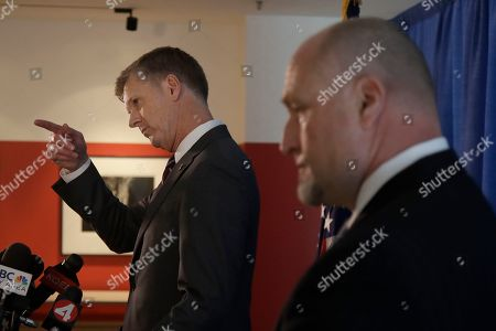 David L. Anderson, U.S. Attorney for the Northern District of California, left, gestures next to John F. Bennett, Special Agent in Charge, Federal Bureau of Investigation, as they speak at a news conference to announce charges against Anthony Levandowski at a federal courthouse in San Jose, Calif., . Levandowski, a former Google engineer, was charged Tuesday with stealing closely guarded secrets that he later sold to Uber as the ride-hailing service scrambled to catch up in the high-stakes race to build robotic vehicles