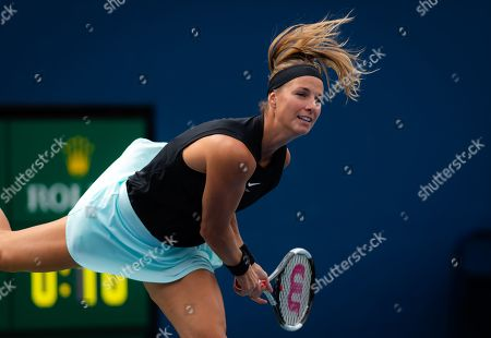 Mandy Minella of Luxembourg in action during her first-round match