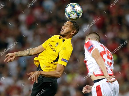 Young Boys' Guillaume Hoarau (L) in action against Red Star?s Dusan Jovancic (R) during the UEFA Champions League playoff, second leg soccer match between BSC Young Boys and Red Star Belgrade in Belgrade, Serbia, 27 August 2019.