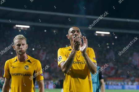 Young Boys' Guillaume Hoarau, right, applauds to supporters at the end of the Champions League play-off, second leg soccer match between Red Star and Young Boys on the stadium Rajko Mitic in Belgrade, Serbia