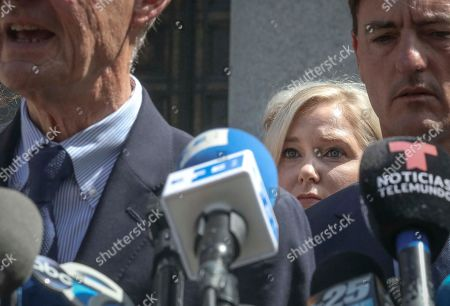 Virginia Roberts Giuffre, center, a sexual assault victim, listen while lawyers David Boies, left, and Brad Edwards stand before microphones during a press conference outside a Manhattan court where sexual victims, on invitation of a judge, addressed a hearing after the accused Jeffrey Epstein killed himself before facing sex trafficking charges, in New York