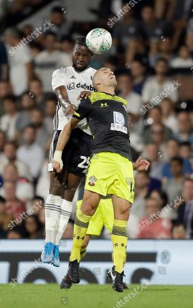 Fulham's Josh Onomah, left, competes for the ball with Southampton's Oriol Romeu during the English League Cup second round soccer match between Fulham and Southampton at Craven Cottage stadium in London