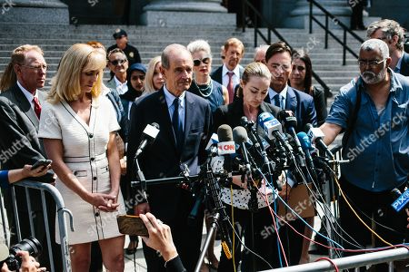 Stock Photo of Chauntae Davies (C), one of deceased financier Jeffrey Epstein's alleged victims,  and lawyer David Boies (C-L) talk to the press outside the United States Federal Courthouse in New York, New York, USA, 27 August 2019.  Epstein's accusers attended a hearing to testify in favor of continuing his trial. Epstein was found dead in his prison cell on 10 August 2019 while awaiting trial on sex trafficking charges.