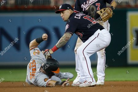Stock Image of Asdrubal Cabrera, DJ Stewart, Hanser Alberto. Washington Nationals second baseman Asdrubal Cabrera (13) makes a tag on Baltimore Orioles' DJ Stewart before throwing to first base to complete the double play on Hanser Alberto during the eighth inning of a baseball game at Nationals Park, in Washington. The Orioles won 2-0