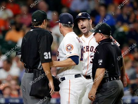 Houston Astros starting pitcher Justin Verlander, facing, argues with home plate umpire Pat Hoberg (31) as A.J. Hinch and first base umpire Greg Gibson get between them after Hoberg ejected Verlander during the sixth inning of a baseball game, in Houston