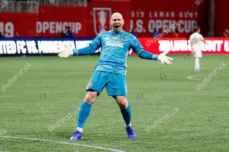 Atlanta United goalkeeper Brad Guzan reacts after the team's 2-1 win over Minnesota United in a soccer match to win the U.S. Open Cup title, in Atlanta