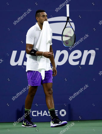 Nick Kyrgios of Australia flips his racquet in the air during his match against Steve Johnson of the United States on the second day of the US Open Tennis Championships the USTA National Tennis Center in Flushing Meadows, New York, USA, 27 August 2019. The US Open runs from 26 August through 08 September.