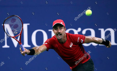 Steve Johnson of the United States returns a shot from Nick Kyrgios of Australia on the second day of the US Open Tennis Championships the USTA National Tennis Center in Flushing Meadows, New York, USA, 27 August 2019. The US Open runs from 26 August through 08 September.