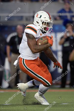 Miami running back Cam'Ron Harris (23) rushes for yardage during the first half of an NCAA college football game against Florida, in Orlando, Fla