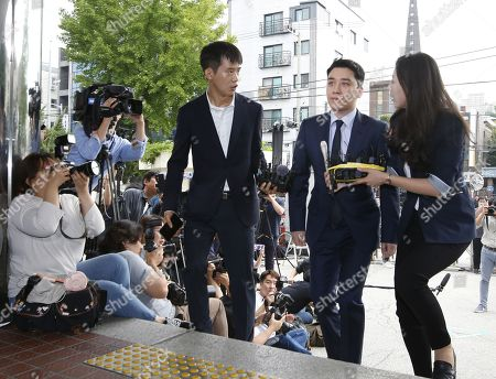 South Korean superstar Lee Seung-hyun (2-R), who is a former member of group Big Bang, arrives at the Seoul Metropolitan Police Agency in Seoul, South Korea, 28 August 2019. Lee Seung-hyun and Yang Hyun-suk, former chief producer and founder of YG Entertainment, will be investigated by police on charges of illegal gambling abroad. They are suspected of gambling up to tens of millions of won at a time at casinos, including the MGM Hotel and Casino in Las Vegas. Gambling is illegal in Korea.