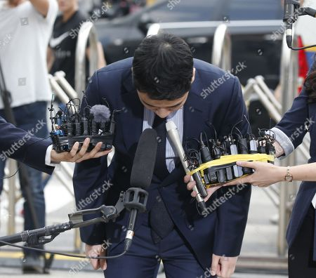 South Korean superstar Lee Seung-hyun, who is a former member of group Big Bang, bows in apology upon his arrival at the Seoul Metropolitan Police Agency in Seoul, South Korea, 28 August 2019. Lee Seung-hyun and Yang Hyun-suk, former chief producer and founder of YG Entertainment, will be investigated by police on charges of illegal gambling abroad. They are suspected of gambling up to tens of millions of won at a time at casinos, including the MGM Hotel and Casino in Las Vegas. Gambling is illegal in Korea.