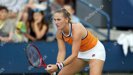 Timea Babos, of Hungary, gets set to return a serve from Carla Suarez Navarro, of Spain, during the first round of the US Open tennis tournament, in New York